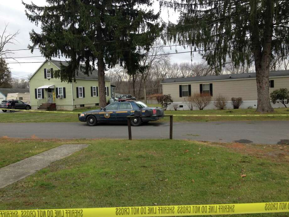 The scene of a murder-suicide on South Hudson Avenue in the Town of Schaghticoke Dec. 23, 2012. Reportedly the suspect entered his wife's house at 180, the home on the left, and allegedly shot her boyfriend. He then exited and went to his wife's grandmother's house on the right, at 178 S. Hudson, and shot himself. (Photo by Staff writer Bryan Fitzgerald)