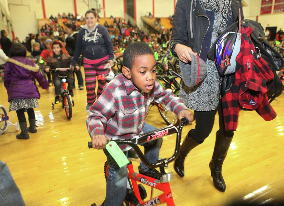 Nehemiah Davis, 4, rides his new bicycle. Photo: Unknown, B.K. Angeletti / Connecticut Post freelance B.K. Angeletti