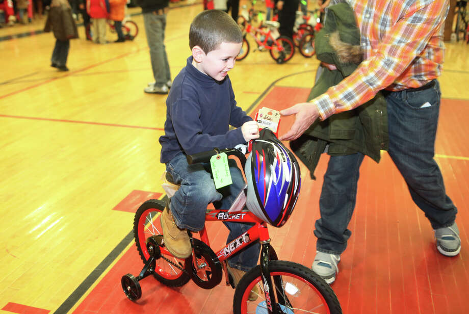 Donte Tracey, 6, rides his new bicycle. Photo: Unknown, B.K. Angeletti / Connecticut Post freelance B.K. Angeletti