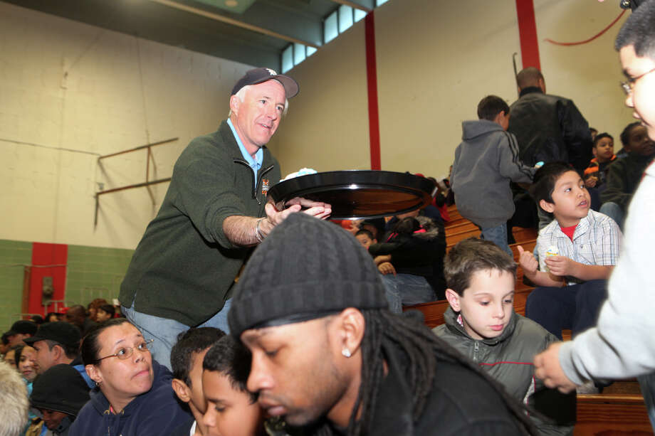 Mayor Bill Finch gives out cupcakes at the Bridgeport Police Department's bike giveaway event at Central High School. Photo: Unknown, B.K. Angeletti / Connecticut Post freelance B.K. Angeletti