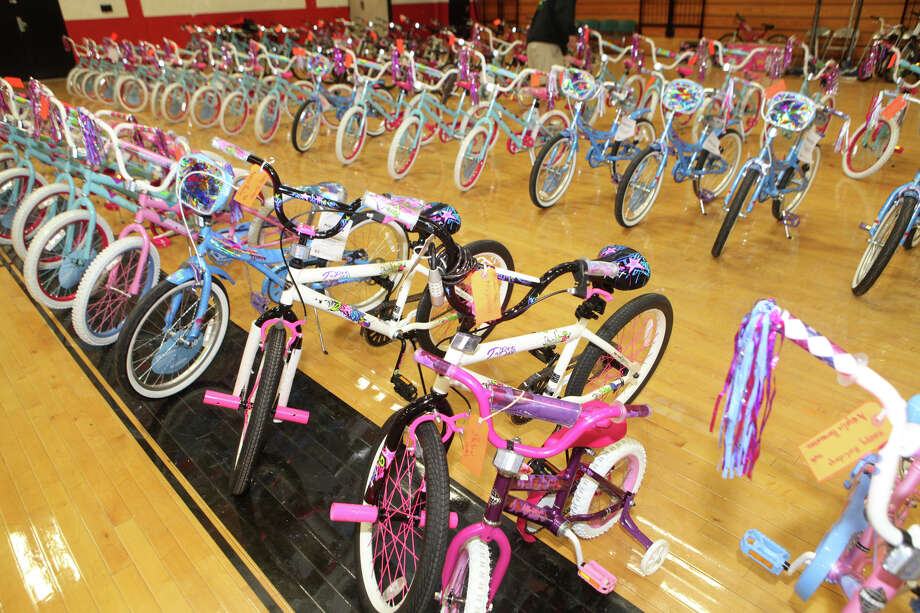 The Bridgeport Police Department gave away 300 bicycles and helmets to city children on Sunday, December 23, 2012. Photo: Unknown, B.K. Angeletti / Connecticut Post freelance B.K. Angeletti