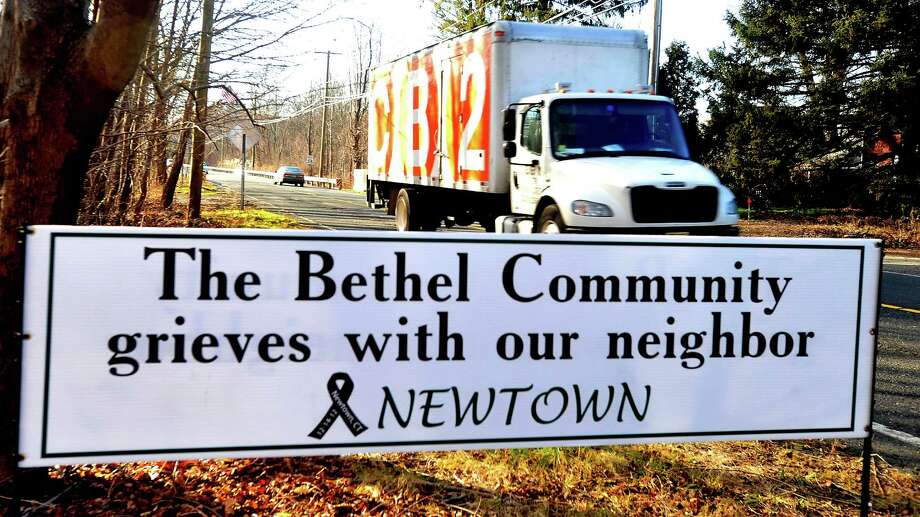 A sign along Route 302 in Bethel shows how the region is affected by the Sandy Hook tragedy. Photographed Sunday, Dec. 23, 2012. Photo: Michael Duffy / The News-Times