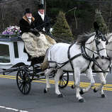 Bloomfield, CT - 10/22/12 - A horse-drawn carriage on E. Wintonbury Avenue, carries Ana Grace Marquez-Greene's casket to The First Cathedral in Bloomfield Saturday for the wake and service to follow.  BRAD HORRIGAN | Hartford Courant