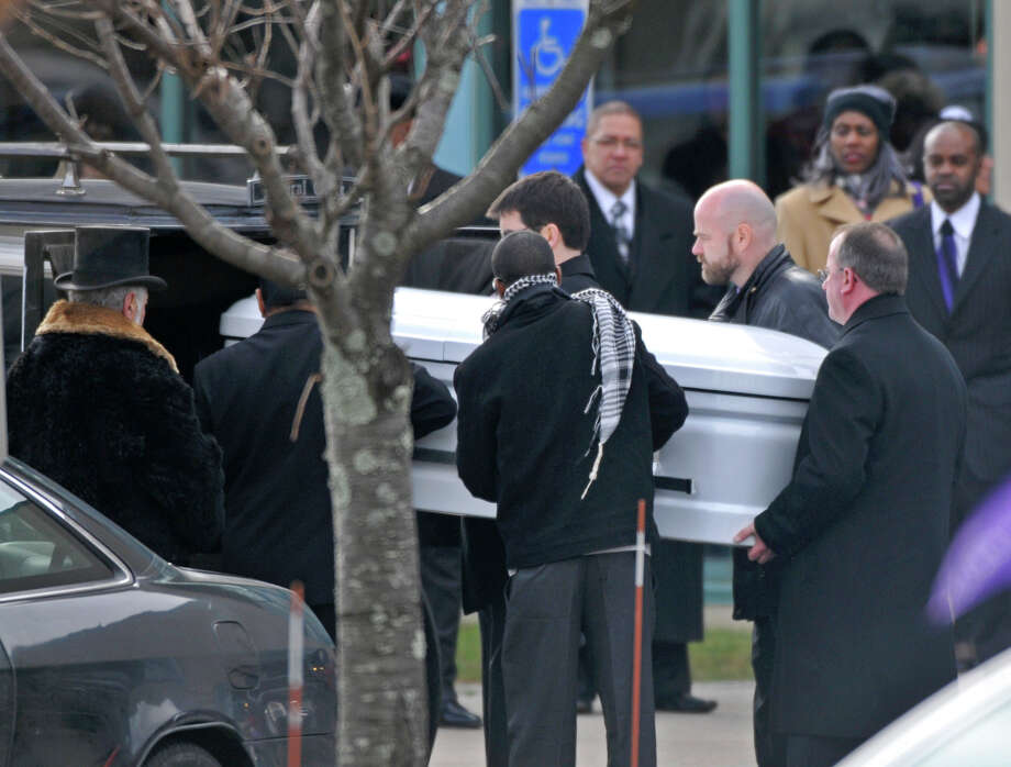 Bloomfield, CT - 10/22/12 - Pall bearers take Ana Grace Marquez-Greene's casket out of a horse drawn carriage at The First Cathedral  in Bloomfield Saturday for the wake and service to follow.  BRAD HORRIGAN | bhorrigan@courant.com Photo: Brad Horrigan / The News-Times