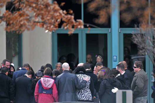 Bloomfield, CT - 10/22/12 - Mourners gather in a circle of prayer around Ana Grace Marquez-Greene's casket before entering The First Cathedral in Bloomfield Saturday for the wake and service to follow.  BRAD HORRIGAN | bhorrigan@courant.com Photo: Brad Horrigan / The News-Times