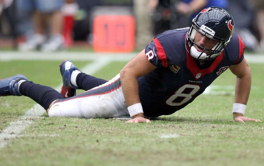 Texans quarterback Matt Schaub stands back up after being knocked to the turf. (Nick de la Torre / Houston Chronicle)