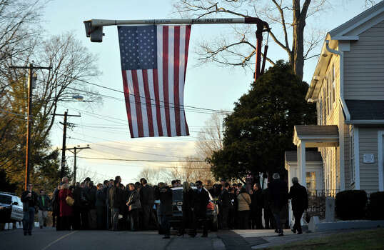 People arrive to the the funeral of Sandy Hook principal Dawn Lafferty Hochsprung at the Munson Lovetere funeral home in Woodbury on Wednesday, Dec. 19, 2012. Photo: Jason Rearick / The News-Times