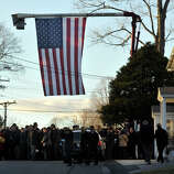 People arrive to the the funeral of Sandy Hook principal Dawn Lafferty Hochsprung at the Munson Lovetere funeral home in Woodbury on Wednesday, Dec. 19, 2012.