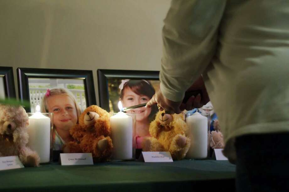 A candle is lit in memory of Madeleine Hsu during a vigil in Pearland, Texas Friday, Dec. 21, 2012. Photo: Kirk Sides, (AP Photo/The Courier, Kirk Sides) / Associated Press