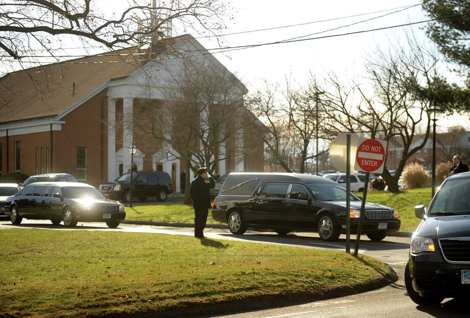A hearse carrying the casket of Catherine Violet Hubbard, one of the twenty students killed in the Sandy Hook Elementary School shooting, exits St. Rose of Lima Catholic Church in Newtown on Thursday, December 20, 2012. Photo: Brian A. Pounds / Connecticut Post