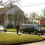 A hearse carrying the casket of Catherine Violet Hubbard, one of the twenty students killed in the Sandy Hook Elementary School shooting, exits St. Rose of Lima Catholic Church in Newtown on Thursday, December 20, 2012.
