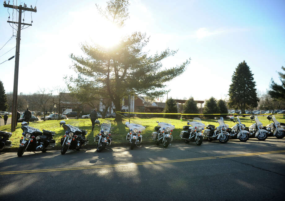 Police motorcycles from across the region are parked outside the funeral of Catherine Violet Hubbard, one of the students killed in the Sandy Hook Elementary School shooting, at St. Rose of Lima Catholic Church in Newtown on Thursday, December 20, 2012. Photo: Brian A. Pounds / Connecticut Post