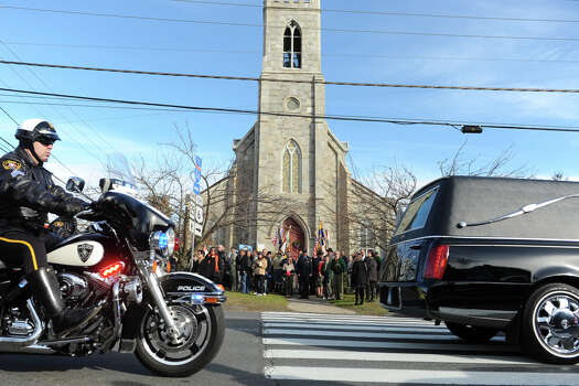 The hearse carrying the body of Jesse McCord Lewis drives down Main Street, in Newtown, Conn., Dec. 20th, 2012. Lewis is one of twenty students killed in the mass shooting at Sandy Hook Elementary School last Friday. Photo: Ned Gerard / Connecticut Post
