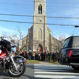 The hearse carrying the body of Jesse McCord Lewis drives down Main Street, in Newtown, Conn., Dec. 20th, 2012. Lewis is one of twenty students killed in the mass shooting at Sandy Hook Elementary School last Friday.