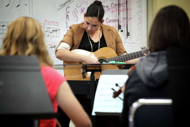 Angela Campos, Orchestra teacher at Wood Middle School in North East ISD, also teaches a Mariachi class. Tuesday, Dec. 11, 2012. Photo: Bob Owen, San Antonio Express-News / © 2012 San Antonio Express-News