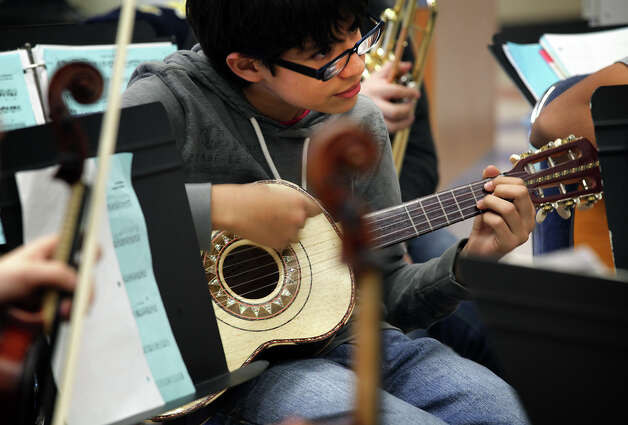 Jose Martinez plays his vihuela in Angela Campos's Mariachi Class at Wood Middle School in North East ISD. Campos also teaches a Orchestra class. Tuesday, Dec. 11, 2012. Photo: Bob Owen, San Antonio Express-News / © 2012 San Antonio Express-News