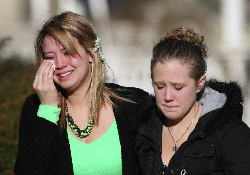 Mourners depart a wake for Jesse Lewis, 6, on December 20, 2012 in Newtown, Connecticut. Jesse was k