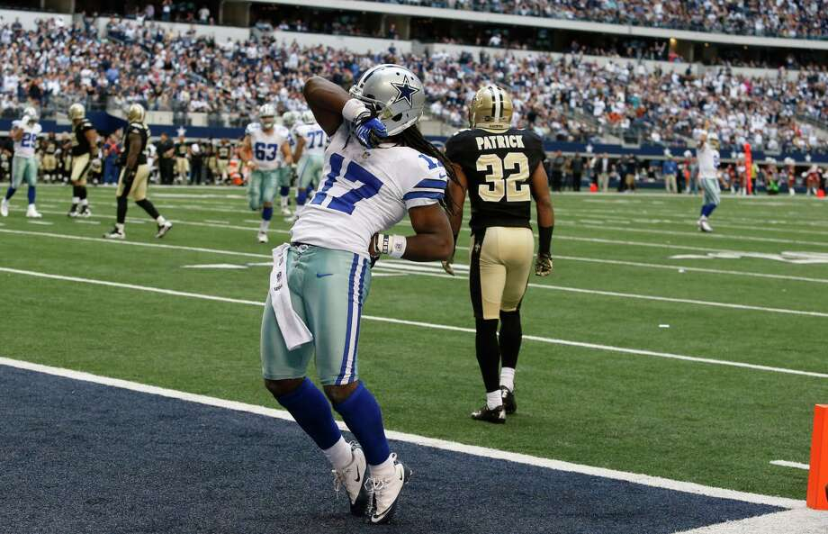 Dallas Cowboys wide receiver Dwayne Harris (17) celebrates scoring a touchdown against New Orleans Saints defensive back Johnny Patrick (32) during the second half of an NFL football game Sunday, Dec. 23, 2012 in Arlington, Texas. (AP Photo/Sharon Ellman) Photo: Sharon Ellman, Associated Press / FR170032 AP