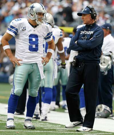 Dallas Cowboys quarterback Tony Romo (9) listens to head coach Jason Garrett during the second half of an NFL football game Sunday, Dec. 23, 2012 in Arlington, Texas. (AP Photo/Sharon Ellman) Photo: Sharon Ellman, Associated Press / FR170032 AP
