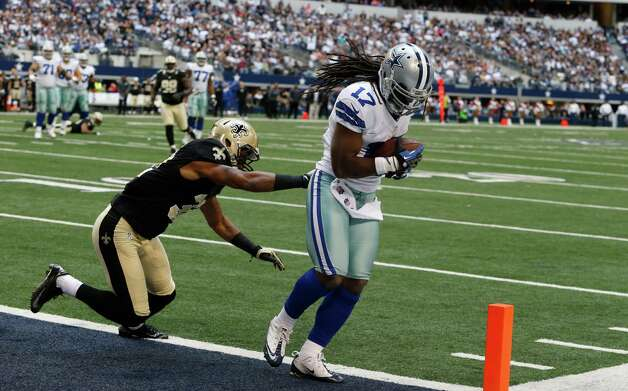 Dallas Cowboys wide receiver Dwayne Harris (17) scores a touchdown against New Orleans Saints defensive back Johnny Patrick (32) during the second half of an NFL football game Sunday, Dec. 23, 2012, in Arlington, Texas. (AP Photo/Sharon Ellman) Photo: Sharon Ellman, Associated Press / FR170032 AP