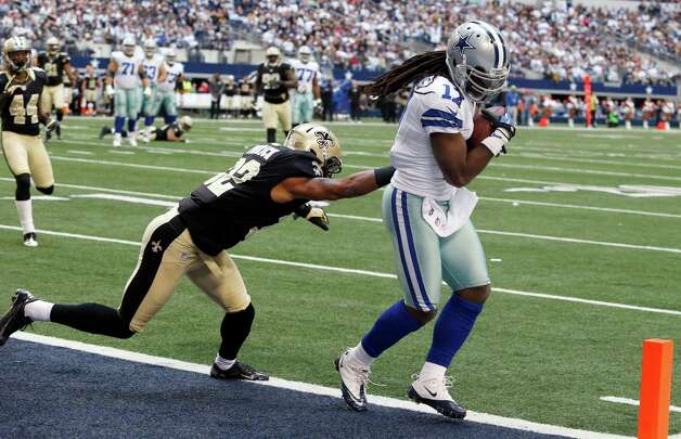 Dallas Cowboys wide receiver Dwayne Harris (17) scores a touchdown as New Orleans Saints defensive back Johnny Patrick (32) defends during the second half of an NFL football game on Sunday, Dec. 23, 2012, in Arlington, Texas. (AP Photo/Sharon Ellman) Photo: Sharon Ellman, Associated Press / FR170032 AP