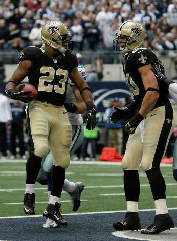 New Orleans Saints running back Pierre Thomas (23) looks to teammate tight end Jimmy Graham (80) after Thomas scored  a touchdown during the second half of an NFL football game against the Dallas Cowboys Sunday, Dec. 23, 2012 in Arlington, Texas. (AP Photo/Brandon Wade) Photo: Brandon Wade, Associated Press / AP