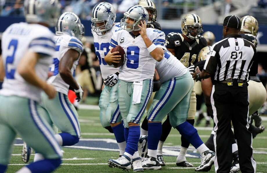 Dallas Cowboys quarterback Tony Romo checks his helmet after a play during the second half of an NFL football game against the New Orleans Saints Sunday, Dec. 23, 2012 in Arlington, Texas. (AP Photo/Sharon Ellman) Photo: Sharon Ellman, Associated Press / FR170032 AP