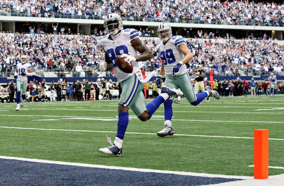 Dallas Cowboys' Dez Bryant heads into the end zone for a touchdown on a pass play against the New Orleans Saints during first half action Sunday Dec. 23, 2012 at Cowboys Stadium in Arlington, Tx. Photo: Edward A. Ornelas, Express-News / © 2012 San Antonio Express-News