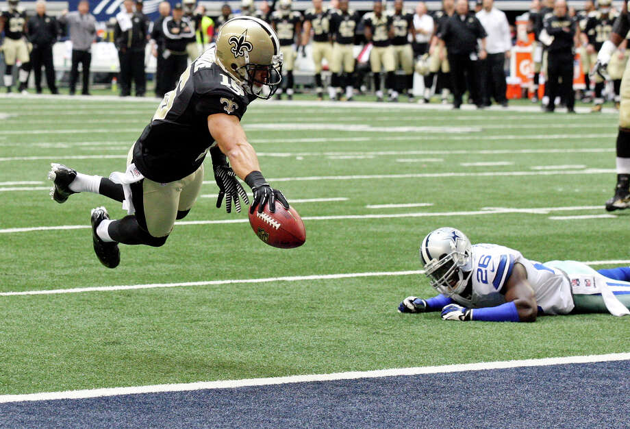 New Orleans Saints' Lance Moore dives for the end zone for a touchdown around Dallas Cowboys' Charlie Peprah during first half action Sunday Dec. 23, 2012 at Cowboys Stadium in Arlington, Tx. Photo: Edward A. Ornelas, Express-News / © 2012 San Antonio Express-News