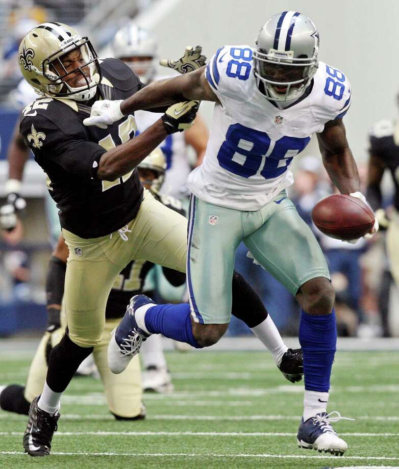 Dallas Cowboys' Dez Bryant looks for room around New Orleans Saints' Isa Abdul-Quddus during first half action Sunday Dec. 23, 2012 at Cowboys Stadium in Arlington, Tx.  Bryant scored a touchdown on the play. Photo: Edward A. Ornelas, Express-News / © 2012 San Antonio Express-News