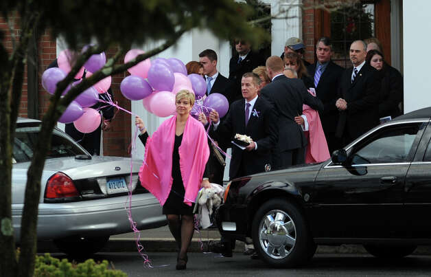 Lynn and Chris McDonnell carry pink and purple balloons fo