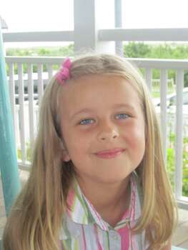 This image provided by the family shows Grace McDonnell posing for a portrait in this family photo taken Aug. 18, 2012. Grace McDonnell was killed Friday, Dec. 14, 2012, when a gunman opened fire at Sandy Hook elementary school in Newtown, Conn., killing 26 children and adults at the school. Photo: Family Photo, AP Photo/Courtesy Of The McDonnell Family) / Associated Press