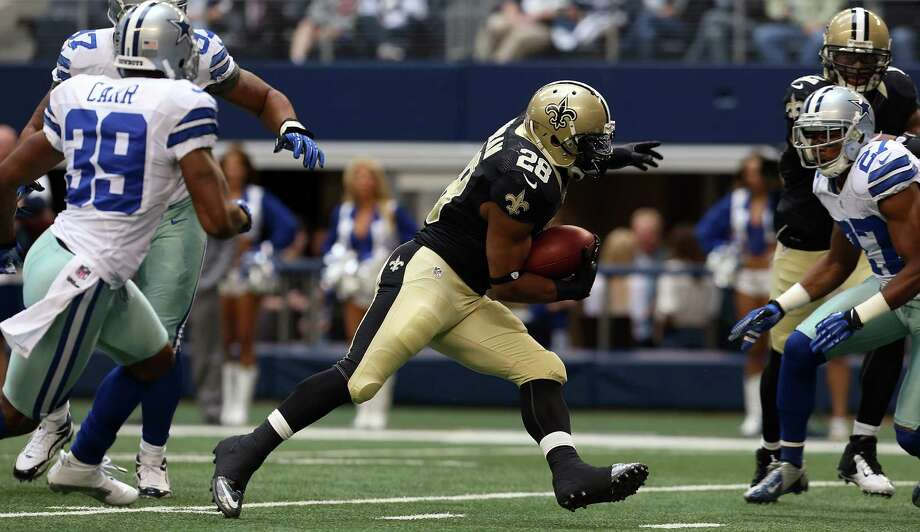 Running back Mark Ingram #28 of the New Orleans Saints beats out cornerback Brandon Carr #39 of the Dallas Cowboys and strong safety Matt Johnson #37 of the Dallas Cowboys to score at Cowboys Stadium on December 23, 2012 in Arlington, Texas. Photo: Tom Pennington, Getty Images / 2012 Getty Images