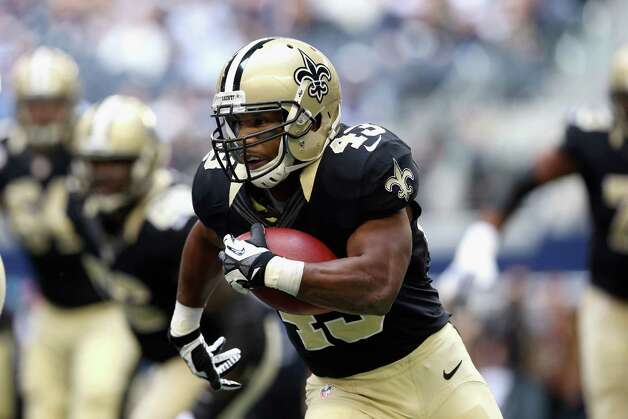Darren Sproles #43 of the New Orleans Saints runs the ball against the Dallas Cowboys at Cowboys Stadium on December 23, 2012 in Arlington, Texas. Photo: Ronald Martinez, Getty Images / 2012 Getty Images
