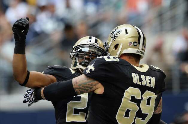 Mark Ingram #28 of the New Orleans Saints celebrates his touchdown with  Eric Olsen #69 against the Dallas Cowboys at Cowboys Stadium on December 23, 2012 in Arlington, Texas. Photo: Ronald Martinez, Getty Images / 2012 Getty Images