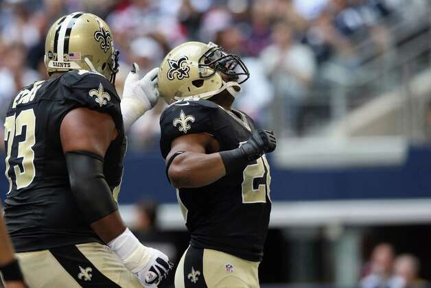 Mark Ingram #28 of the New Orleans Saints celebrates his touchdown with  Jahri Evans #73 against the Dallas Cowboys at Cowboys Stadium on December 23, 2012 in Arlington, Texas. Photo: Ronald Martinez, Getty Images / 2012 Getty Images