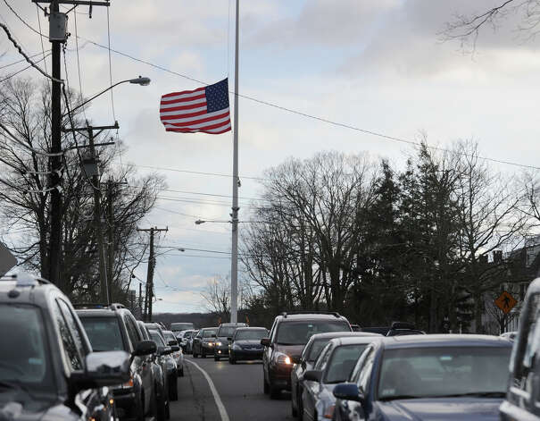The American Flag in the center of Newtown, Conn., at half-staff in memory of the victims of the Sandy Hook Elementary School massacre, Saturday afternoon, Dec. 22, 2012. Photo: Bob Luckey / Greenwich Time