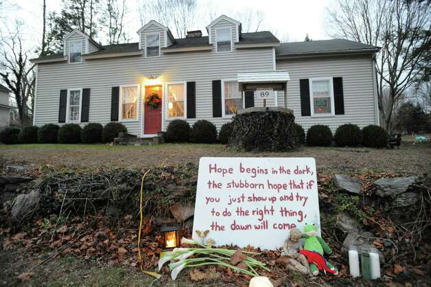 A sign about hope on the front lawn of a Church Hill Road home leading into downtown Sandy Hook, Conn., Saturday, Dec. 22, 2012. It has been more than a week since Adam Lanza slaughtered 26 people at Sandy Hook Elementary School with an automatic weapon. Photo: Bob Luckey / Greenwich Time