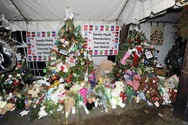 Christmas trees in memory of the victims of the Sandy Hook Elementary School massacre on Riverside Road in Newtown, Conn., Saturday night, Dec. 22, 2012. Photo: Bob Luckey / Greenwich Time