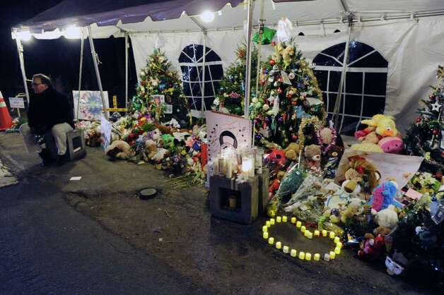 Christmas trees in memory of the victims of the Sandy Hook Elementary School massacre on Dickinson Drive in Newtown, Conn., Saturday night, Dec. 22, 2012. Photo: Bob Luckey / Greenwich Time