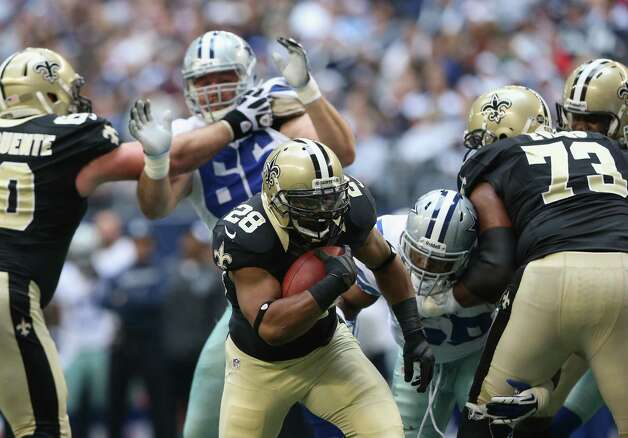 Mark Ingram #28 of the New Orleans Saints runs for a touchdown against the Dallas Cowboys at Cowboys Stadium on December 23, 2012 in Arlington, Texas. Photo: Ronald Martinez, Getty Images / 2012 Getty Images