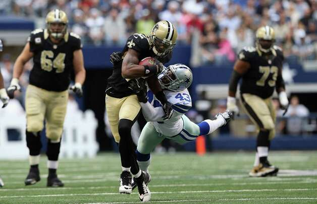 Marques Colston #12 of the New Orleans Saints runs the ball past Gerald Sensabaugh #43 of the Dallas Cowboys at Cowboys Stadium on December 23, 2012 in Arlington, Texas. Photo: Ronald Martinez, Getty Images / 2012 Getty Images