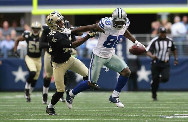 Dez Bryant #88 of the Dallas Cowboys runs for a touchdown past  Isa Abdul-Quddus #42 of the New Orleans Saints at Cowboys Stadium on December 23, 2012 in Arlington, Texas. Photo: Ronald Martinez, Getty Images / 2012 Getty Images