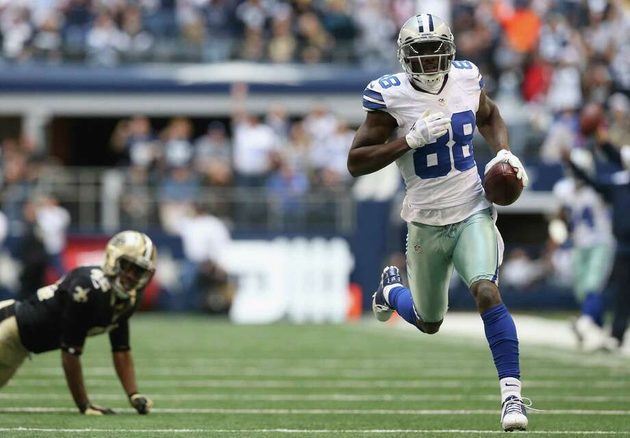 Dez Bryant #88 of the Dallas Cowboys runs for a touchdown against the New Orleans Saints at Cowboys Stadium on December 23, 2012 in Arlington, Texas. Photo: Ronald Martinez, Getty Images / 2012 Getty Images