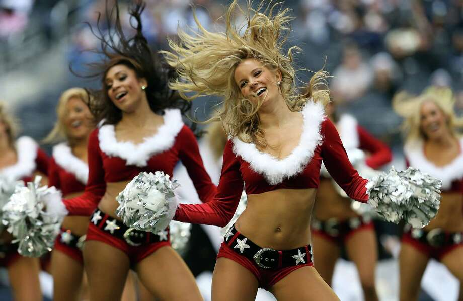 The Dallas Cowboys Cheerleaders perform as the Dallas Cowboys take on the New Orleans Saints at Cowboys Stadium on December 23, 2012 in Arlington, Texas. Photo: Tom Pennington, Getty Images / 2012 Getty Images