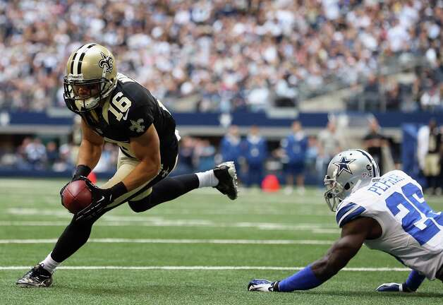 Lance Moore #16 of the New Orleans Saints runs for a touchdown past  Charlie Peprah #26 of the Dallas Cowboys at Cowboys Stadium on December 23, 2012 in Arlington, Texas. Photo: Ronald Martinez, Getty Images / 2012 Getty Images