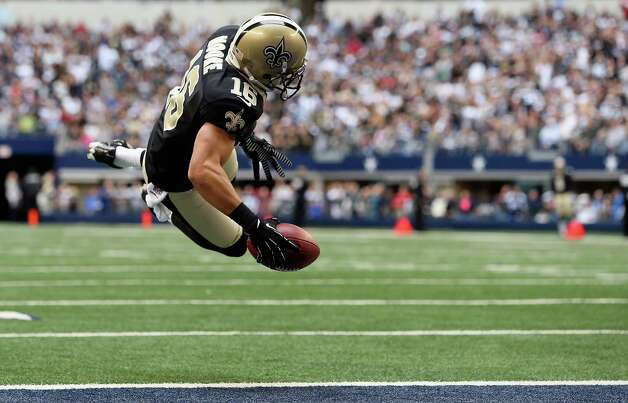 Lance Moore #16 of the New Orleans Saints dives into the endzone for a touchdown against the Dallas Cowboys at Cowboys Stadium on December 23, 2012 in Arlington, Texas. Photo: Ronald Martinez, Getty Images / 2012 Getty Images