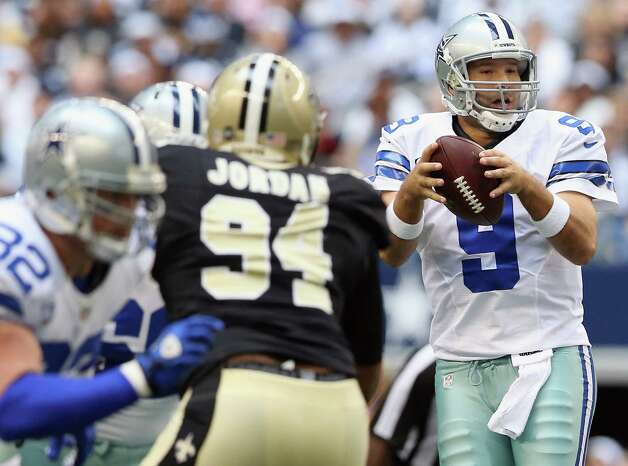 Tony Romo #9 of the Dallas Cowboys throws a pass against the New Orleans Saints at Cowboys Stadium on December 23, 2012 in Arlington, Texas. Photo: Ronald Martinez, Getty Images / 2012 Getty Images