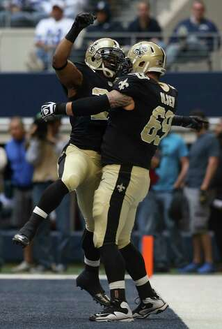 Running back Mark Ingram #28 of the New Orleans Saints celebrates with guard Eric Olsen #69 of the New Orleans Saints after scoring against the Dallas Cowboys at Cowboys Stadium on December 23, 2012 in Arlington, Texas. Photo: Tom Pennington, Getty Images / 2012 Getty Images
