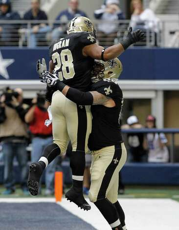 New Orleans Saints running back Mark Ingram (28) celebrates his touchdown with teammate Eric Olsen (69) during the first half of an NFL football game against the Dallas Cowboys  Sunday, Dec. 23, 2012 in Arlington, Texas. (AP Photo/Brandon Wade) Photo: Brandon Wade, Associated Press / AP